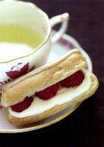 Eclairs with fresh cream and raspberries