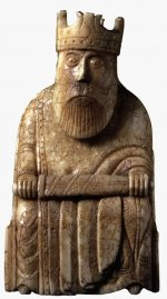 Ivory chess piece in the shape of a seated king